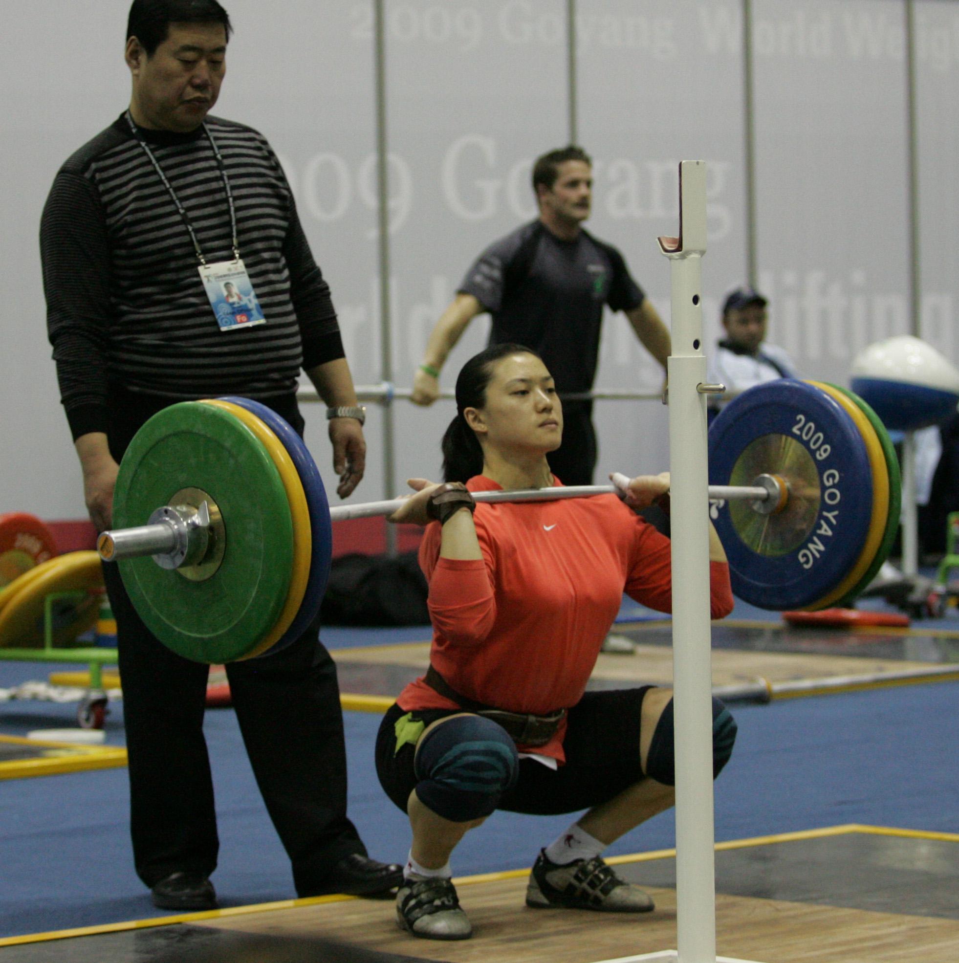 CAO Lei squatting